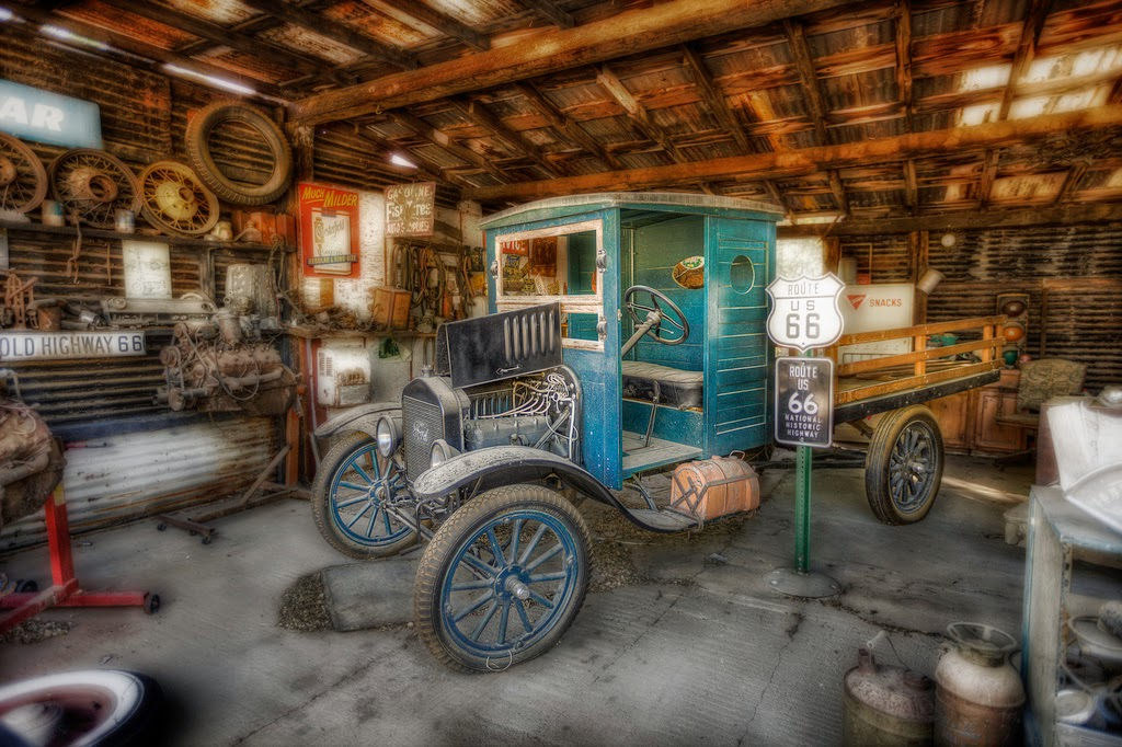 "A general store on Route 66 featuring ""a little Ford"" [LAST]"