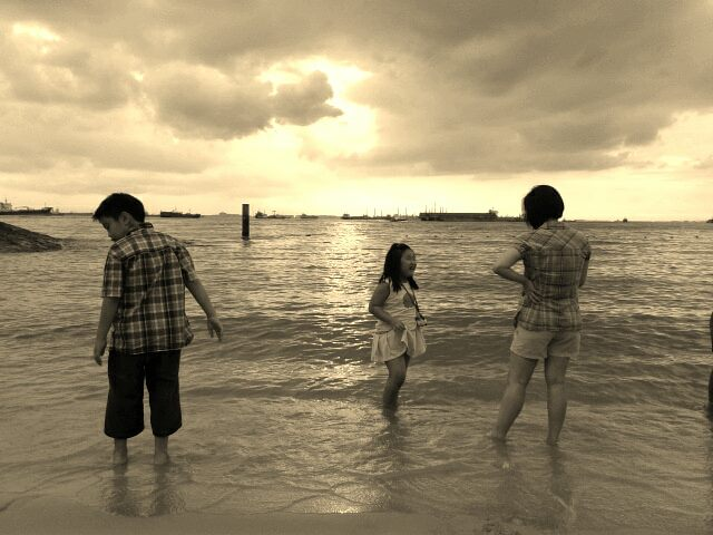Kids playing in the sand, Siloso Beach, Singapore