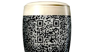 New Guinness &#39;QR cup&#39;: pint beer glass with etched QR code that&#39;s visible only after glass is filled with Guinness Black Stout Beer.