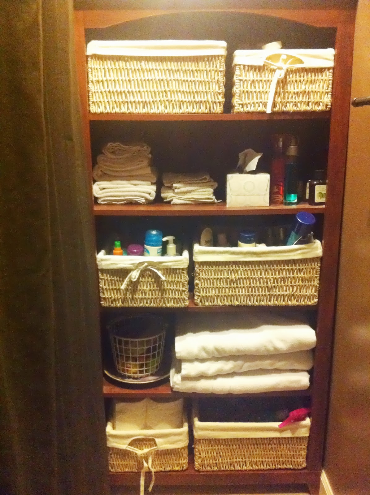 Basically organized limited bathroom storage space add a - Bathroom storage baskets shelves ...