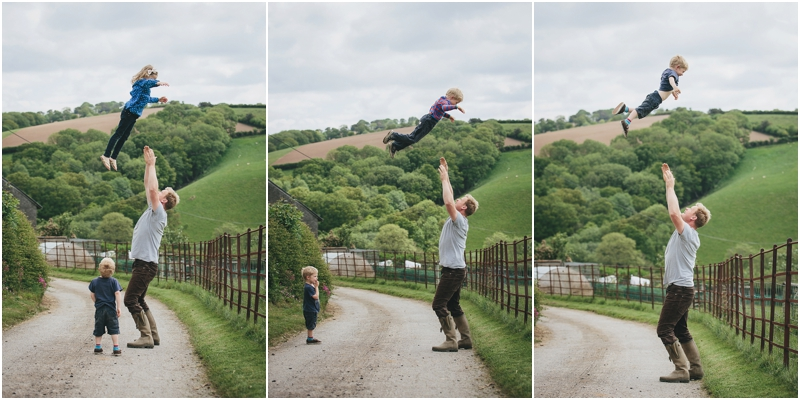 A father throwing his children in the air
