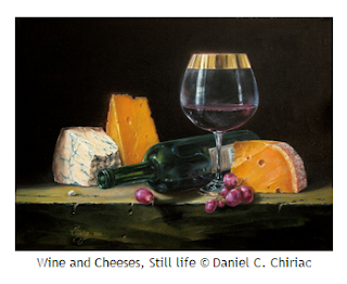 three cheese wedges, goblet and bottle of red wine with grapes