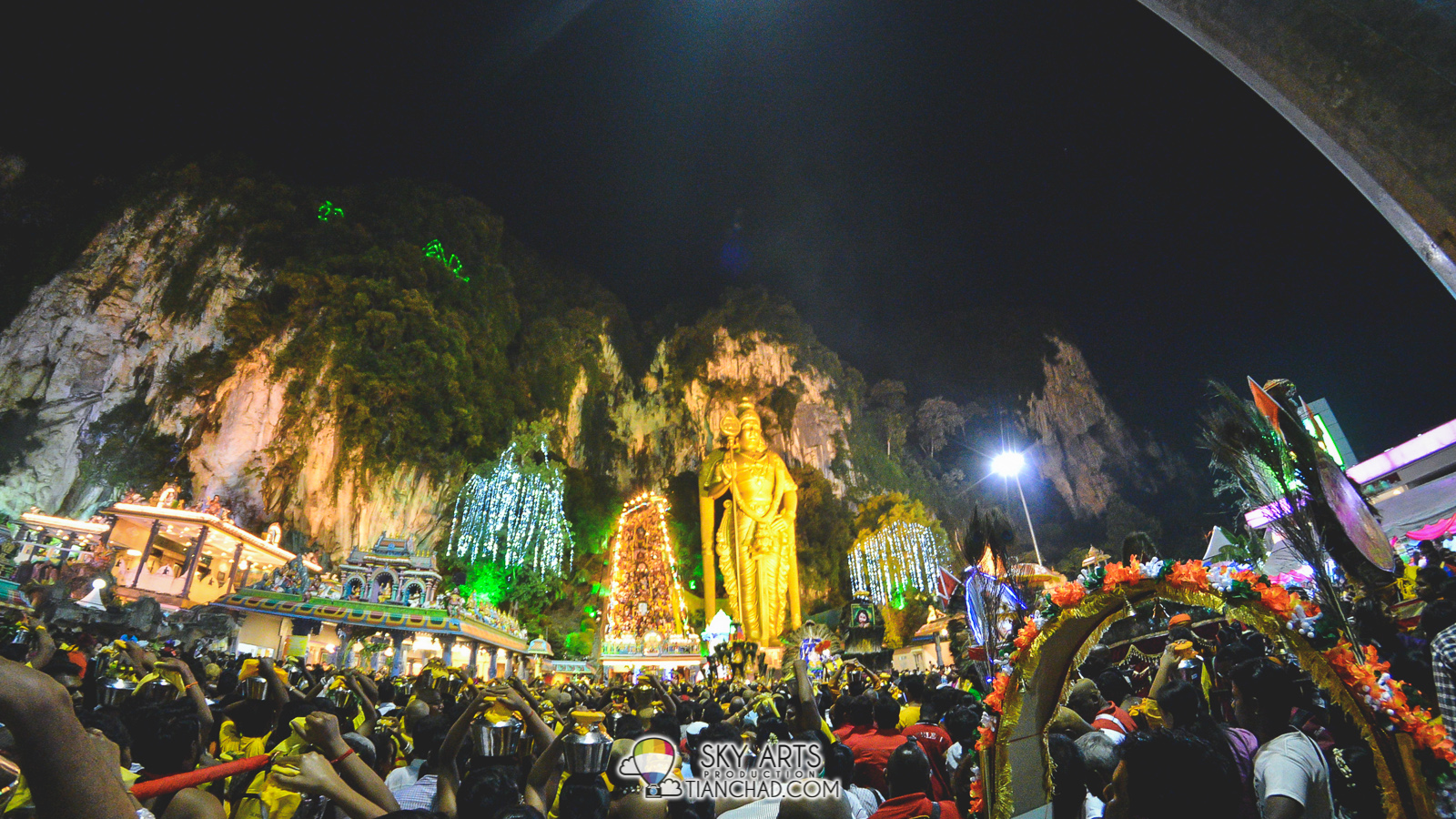 Fisheye view of Batu Caves with the Golden Statue and people mountain people sea World's tallest statue of the Hindu deity Lord Murugan
