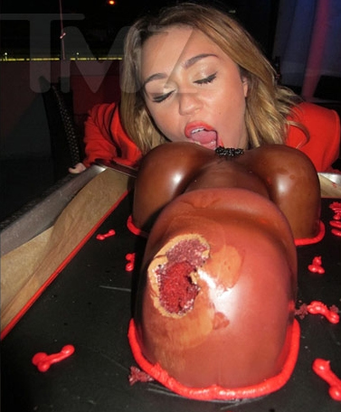 This Is a Picture of Miley Cyrus Eating a Penis Cake
