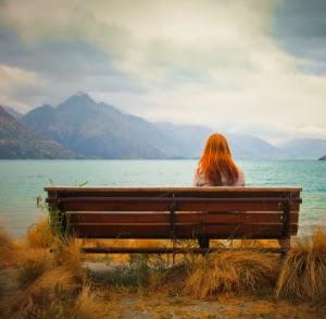 Alone girl  near river sad