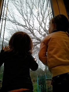 girls watching the rain
