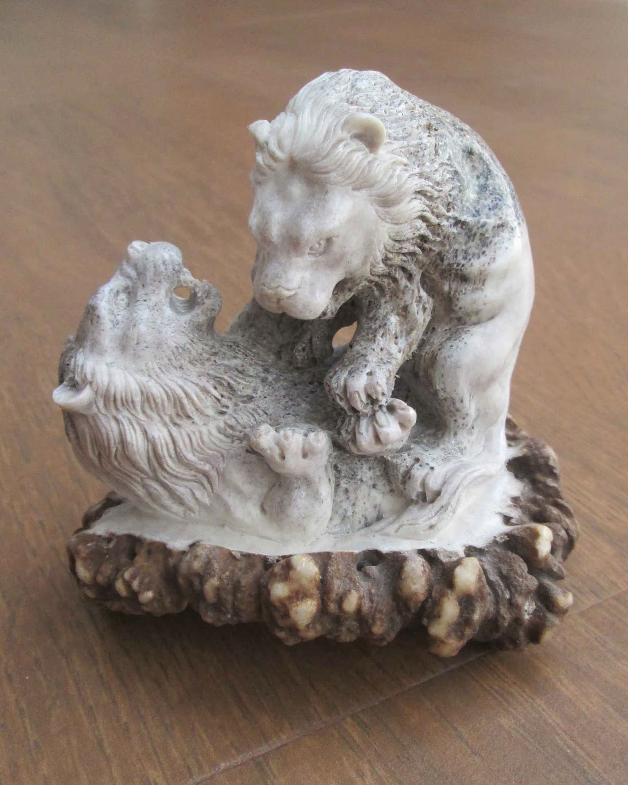 Hand Carved Fighting Lion in Elk Antler