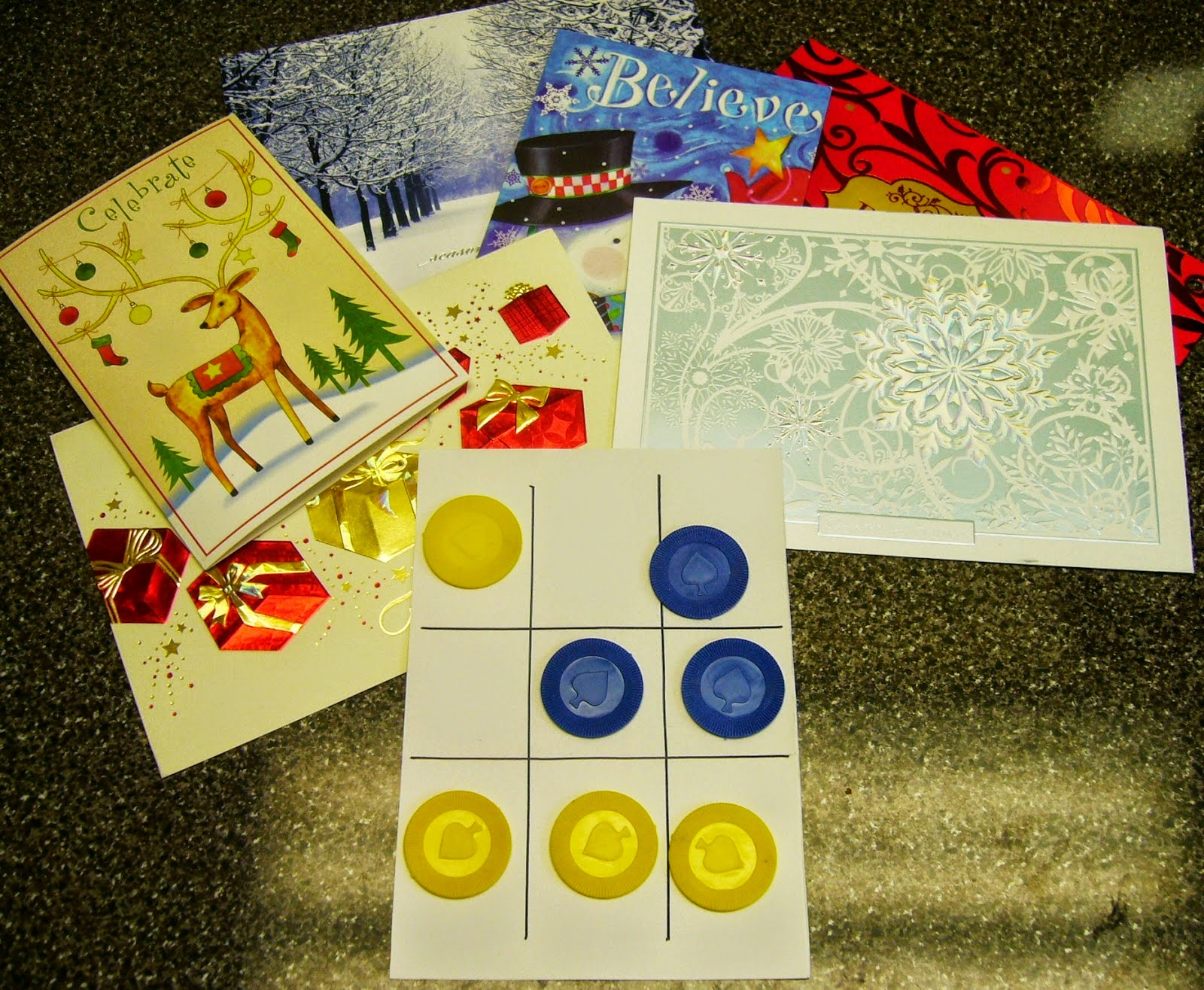 http://www.simplyshoeboxes.com/2015/02/tic-tac-toe-game-from-upcycled-greeting.html