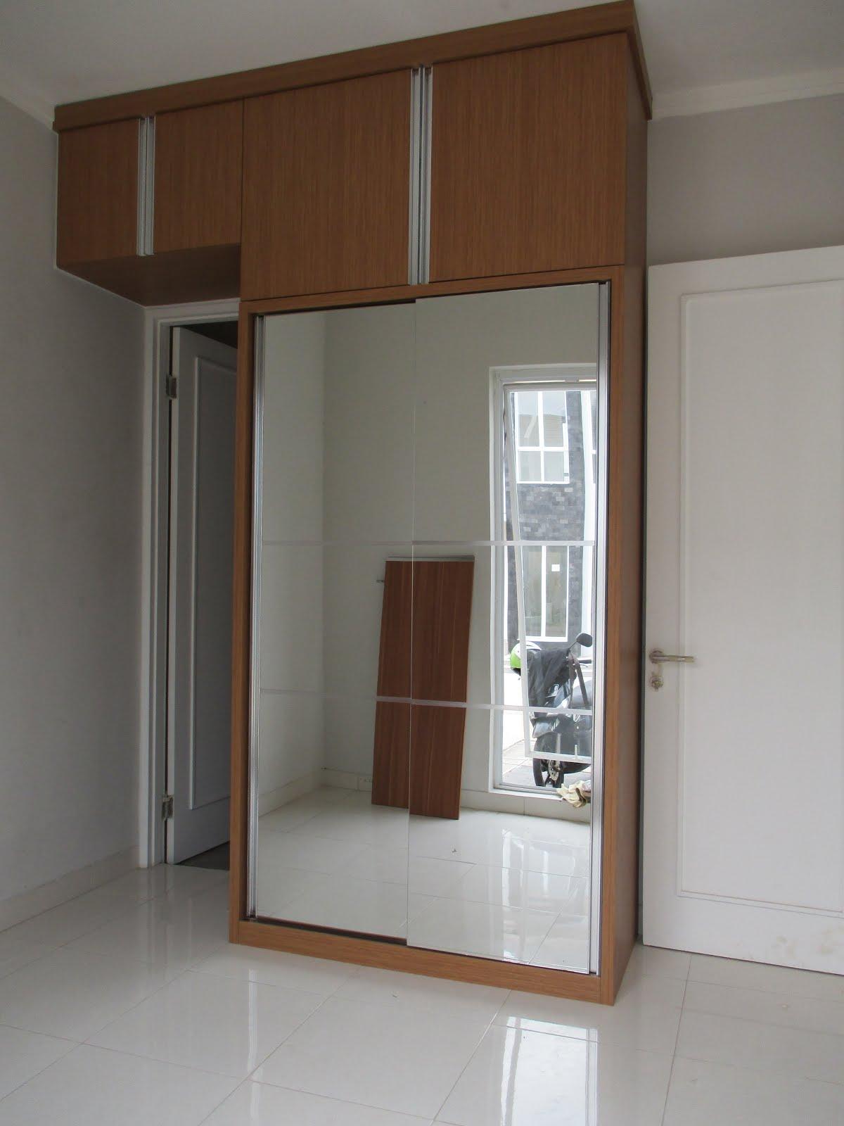 Lemari pakaian pintu sliding ful kaca cermin