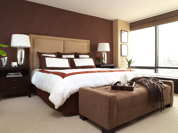 brown provides a dramatic backdrop for a minimalist modern bedroom