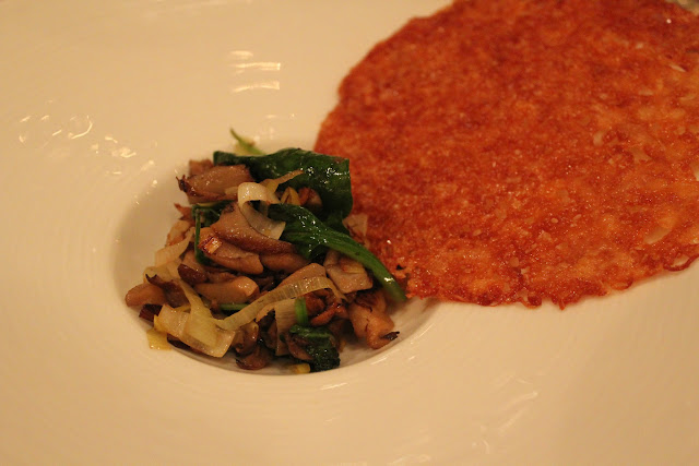 Montasio cheese frico with wild mushrooms and leeks at Meritage, Boston, Mass.