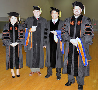 Receiving Ph.D. degrees (l to r) were: Hee Joo Kim, Sam Swindell, Kyung Yon Jhi and Joshua Hill.