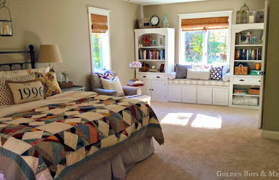 Pottery Barn quilt with built in window seat in master bedroom via www.goldenboysandme.com
