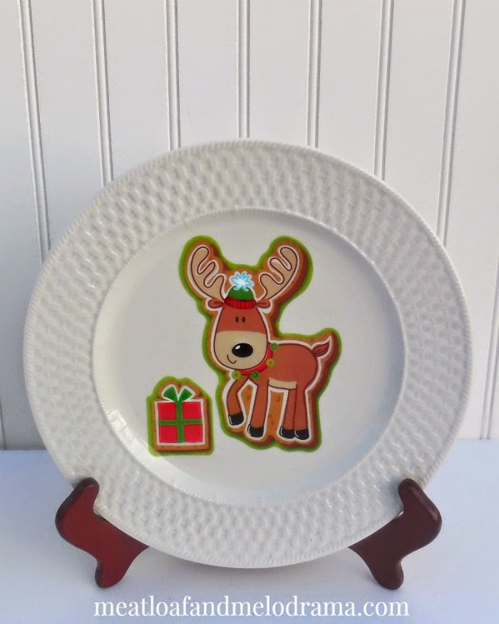 reindeer with present on a white plate for christmas