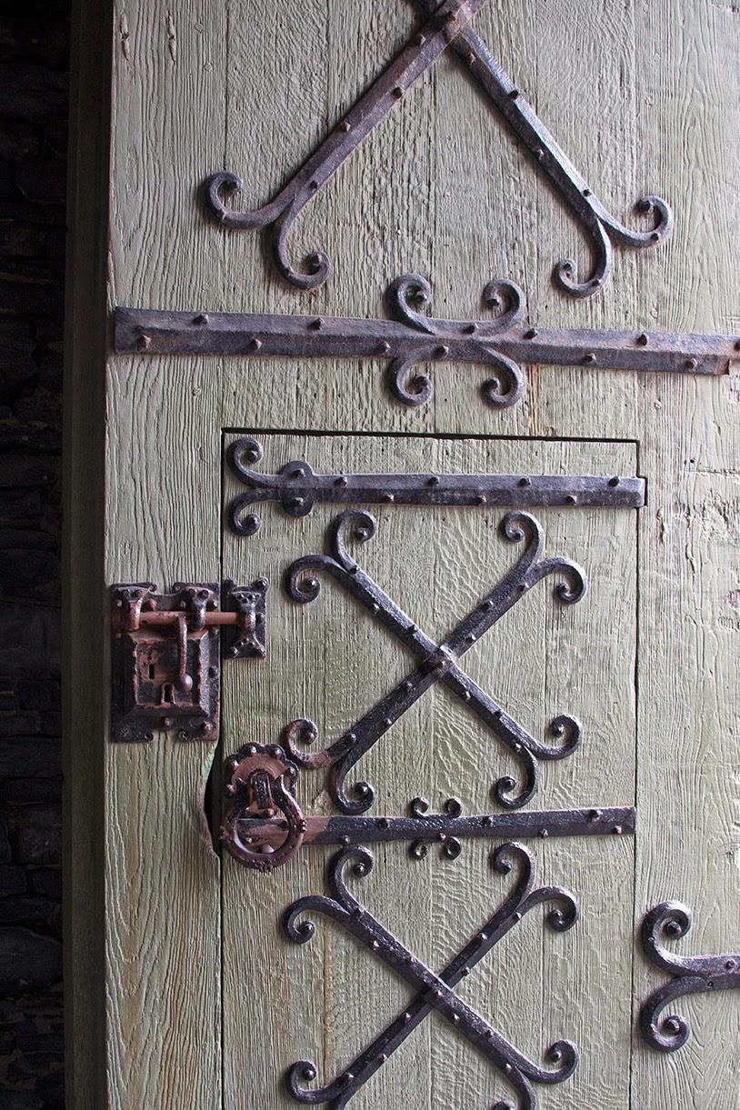 light green heavy wooden door of the castle
