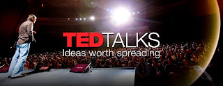Image of the TEDtalk logo with a speaker giving a talk to an audience as the background