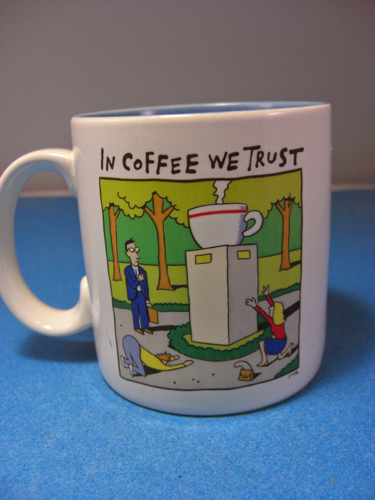 http://bargaincart.ecrater.com/p/22229669/in-coffee-we-trust-mug-idol