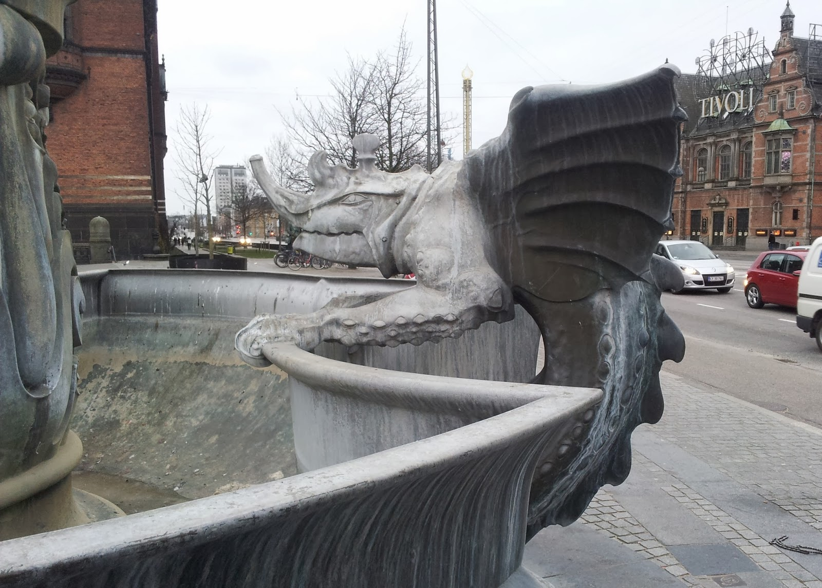 Gargoyle sculpture on dry fountain in Copenhagen