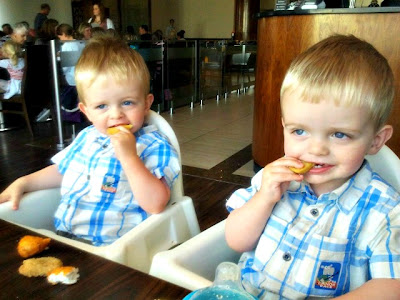 Toddler twins eating out at Cosmo's