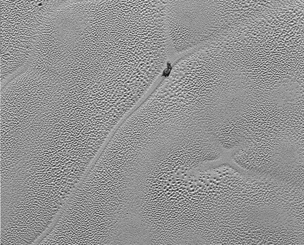 X en Plutón