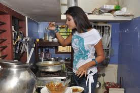 Amala Paul is preparing food