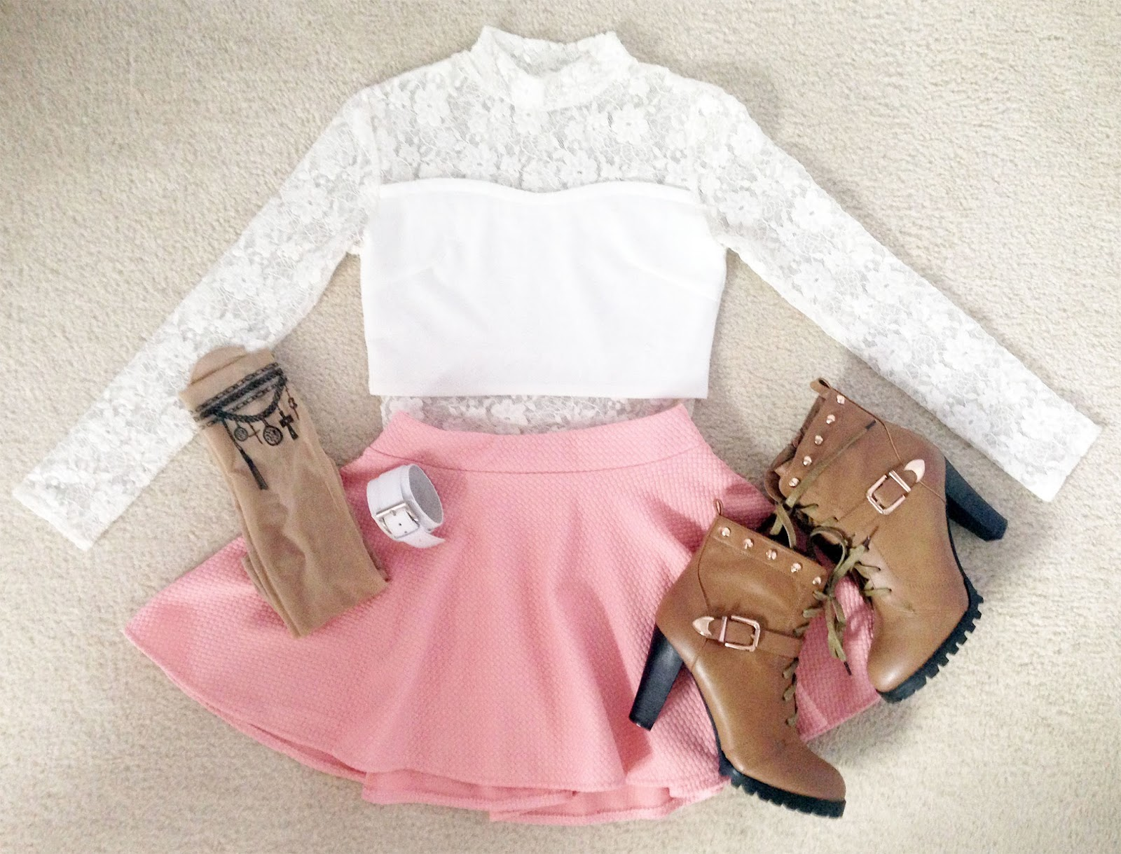 Layout of Chicnova pastel pink skater skirt, Snidel lace crop top, tattoo tights, leather bracelet, and high heeled brown boots for a brunch/tea-party inspired springtime look for fall!