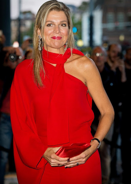Queen Maxima wore the same Valentino one Shoulder Jumpsuit in Red.