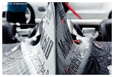 mclaren formula one car covered in water droplets