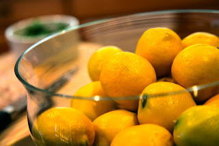 Large bowl of lemons are ingredients to prepare Lemon Risotto