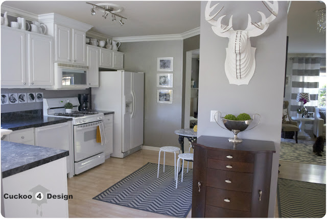 white kitchen with milk glass and chevron rug
