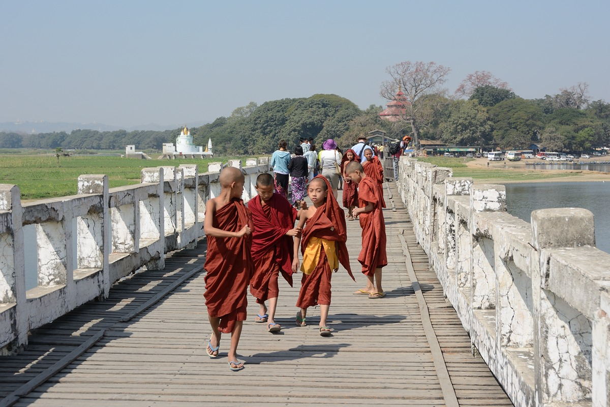 Young monks on U Bein bridge at Amarapura