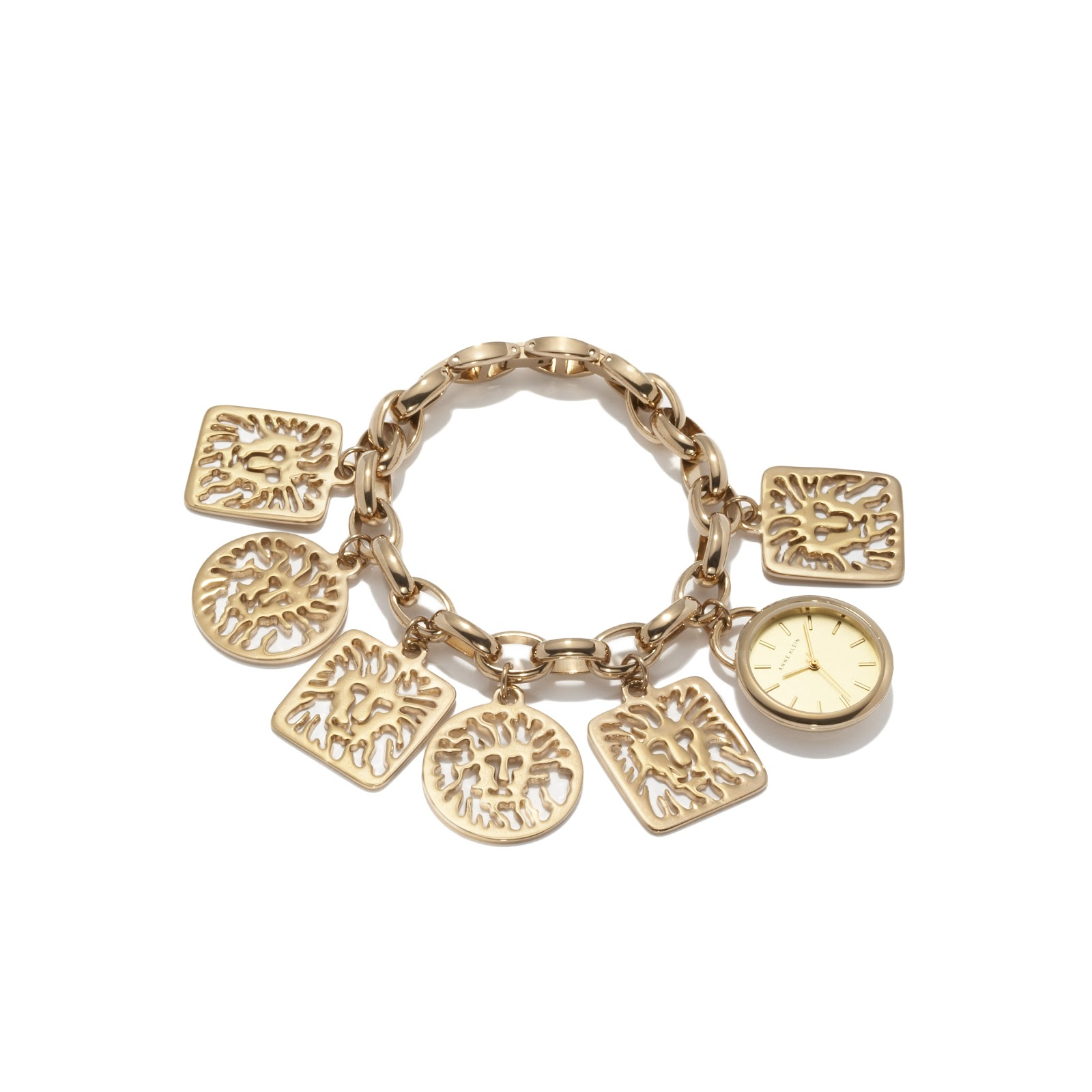 The Lion Head Logo Takes Center Stage On This Whimsical Gold Tone Charm Bracelet Watch Six Large Dangling Square And Round Charms With Hang