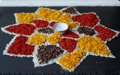coloured rice rangoli pattern