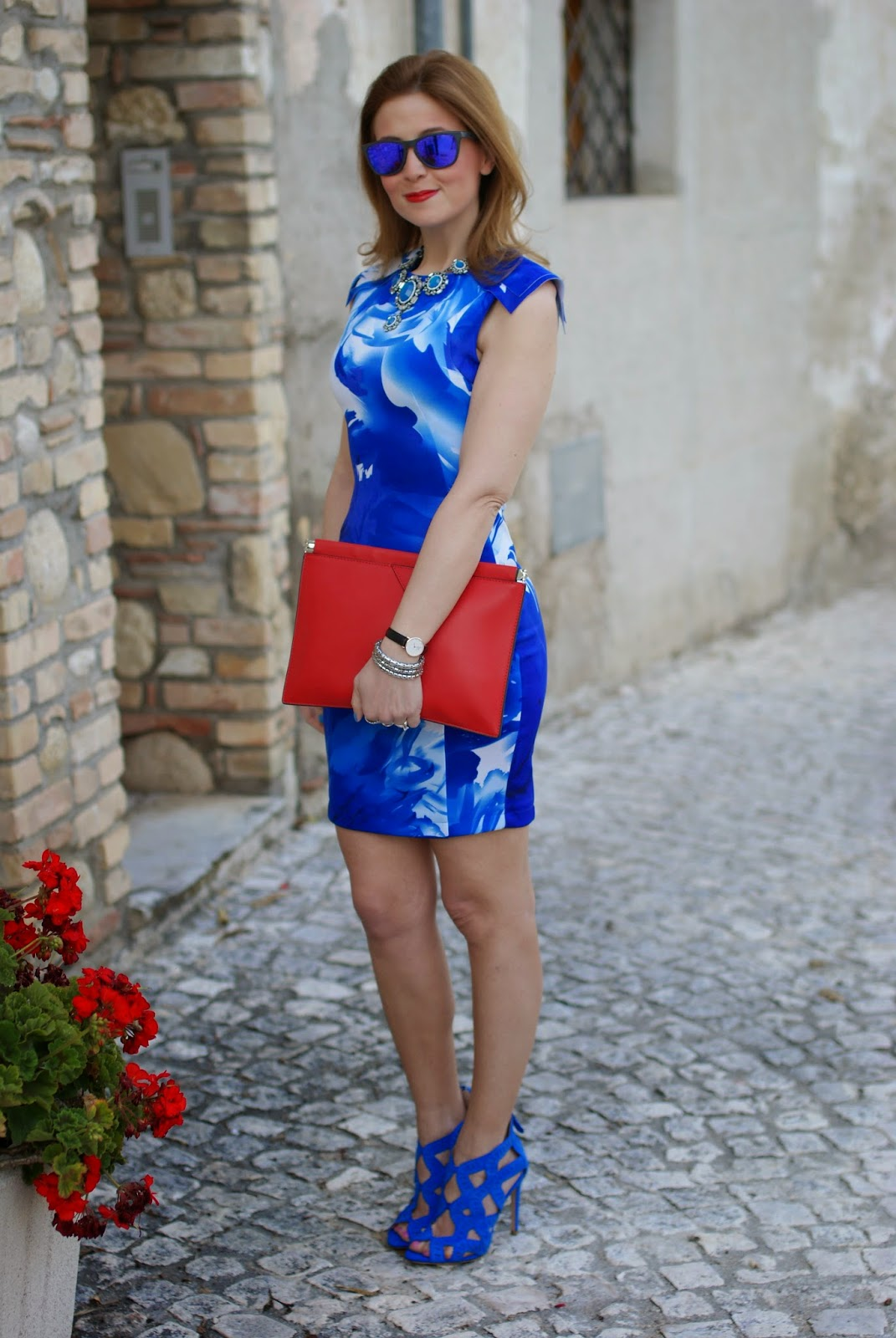 Red clutch, blackfive dress, blue high heels, Oakley blue mirror sunglasses, Fashion and Cookies, fashion blogger