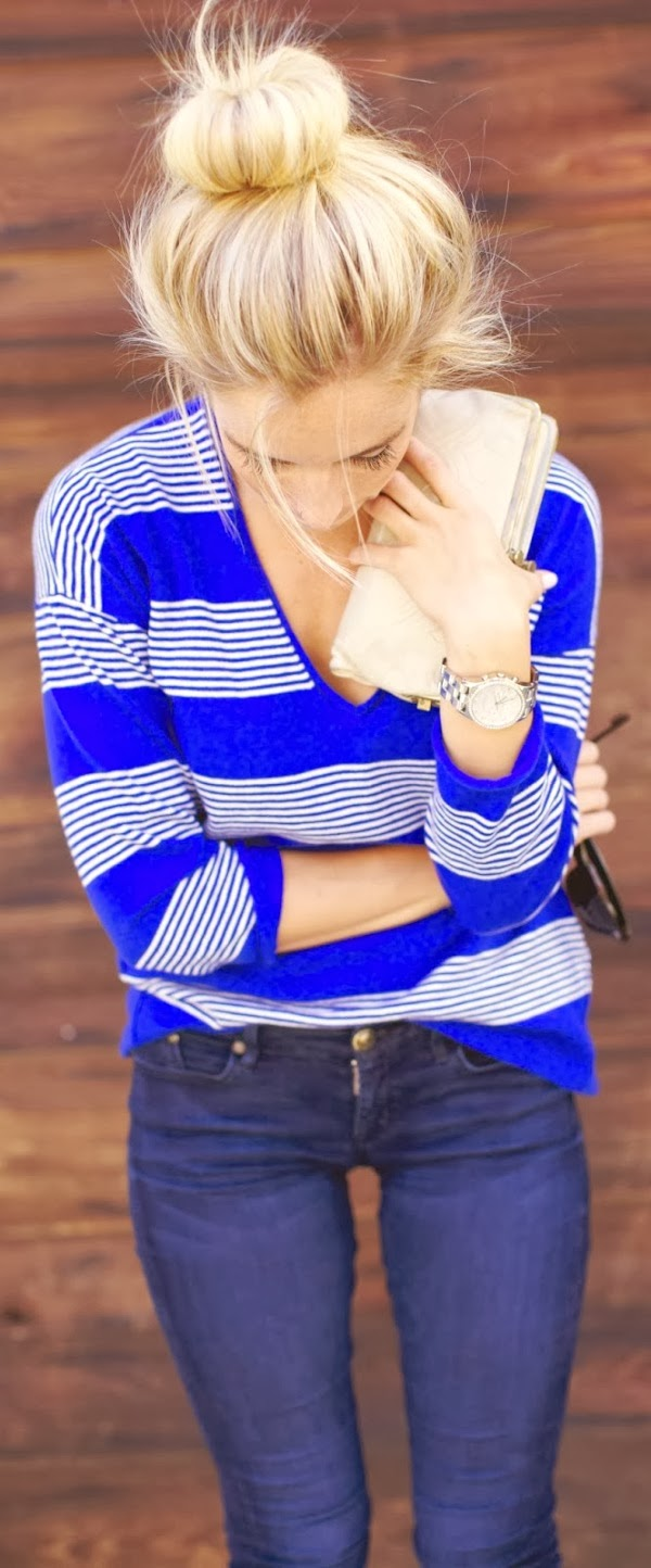 Lovely hair bun and colorful stripes sweater shirt