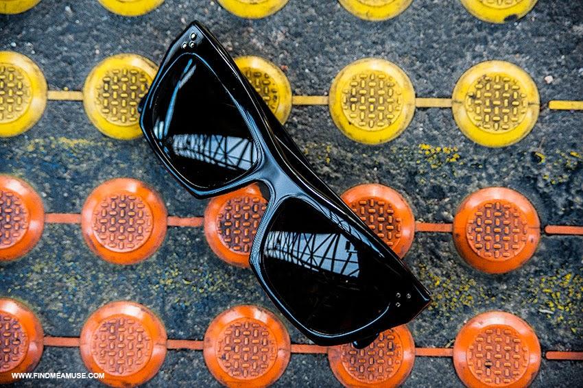 Find Me A Muse blog close up details of Celine catseye sunglasses against coloured concrete