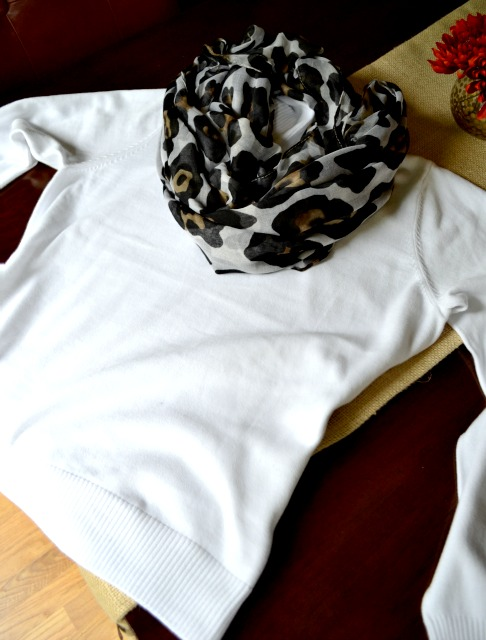 white sweater with leopard print scarf