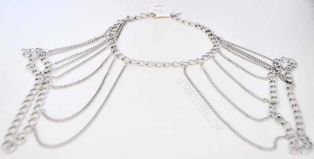 Born Pretty Store's silver body chain fits like a shoulder harness, with a necklace-style loop along with loops around the arms.