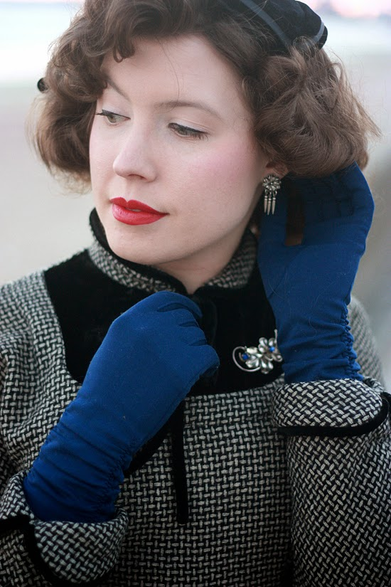 Black and white basketweave wool dress with royal blue gloves and southwestern silver jewelry
