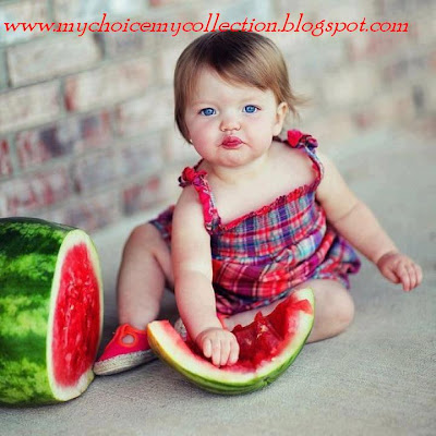 cute baby eating watermelon