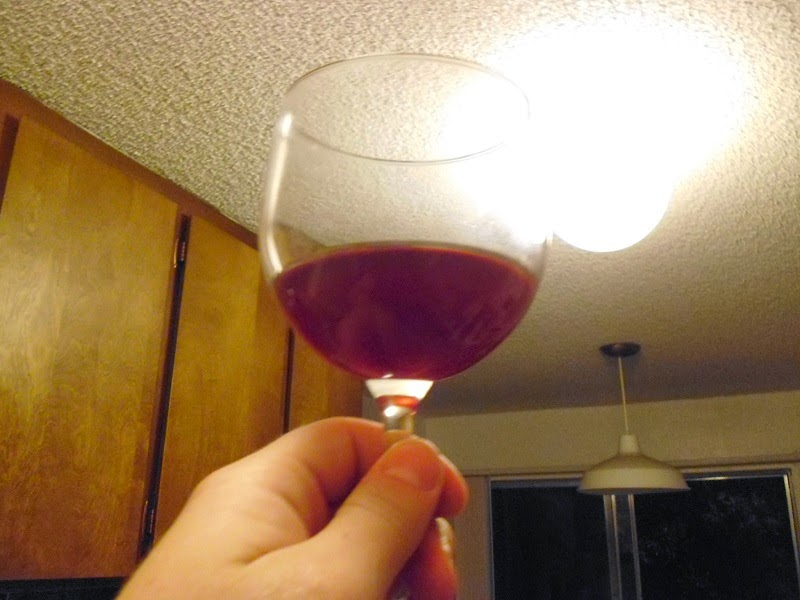 Concord Grape wine pour