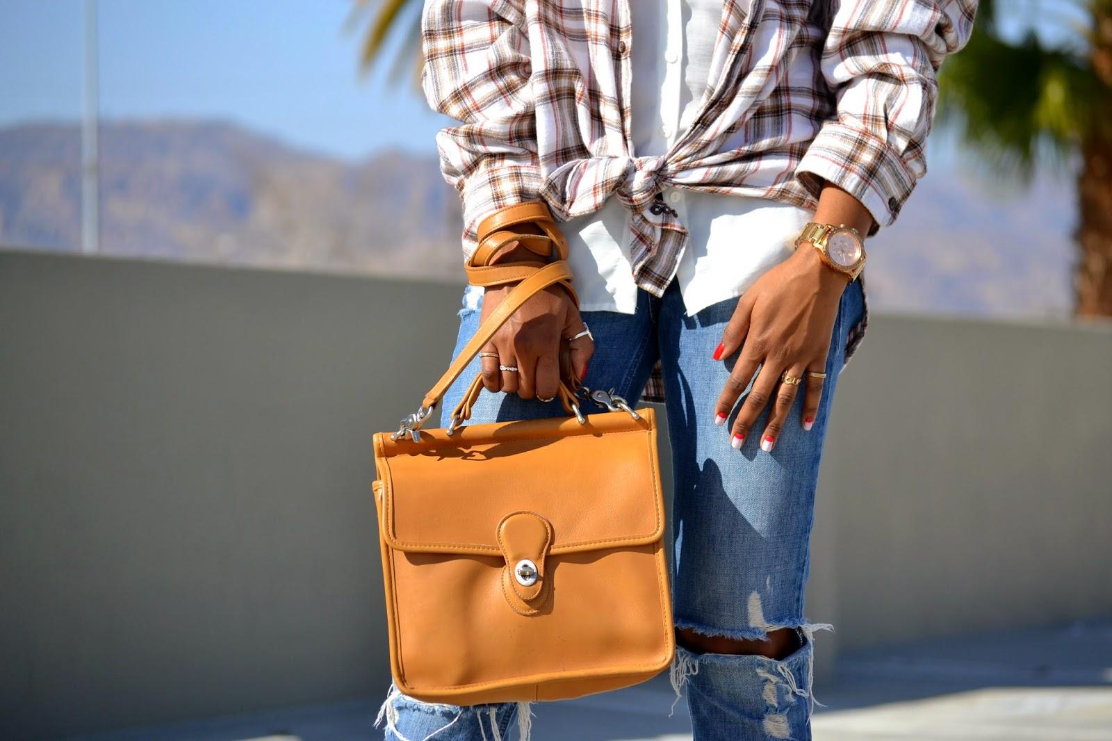 Wearing Coach Willis bag with rose gold Nixon watch