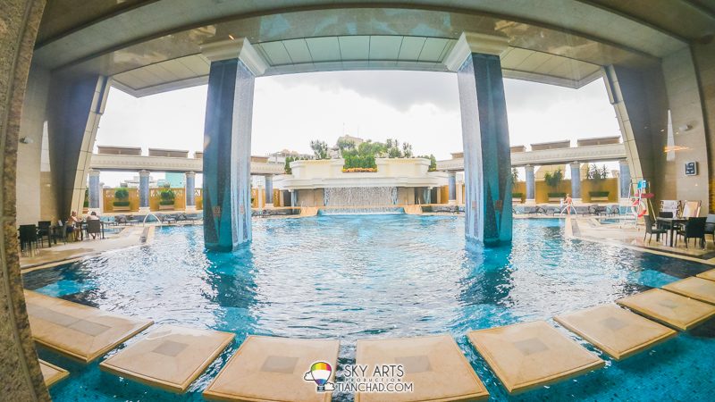 Spacious swimming pool with waterfall as part of their design in Grand Lisboa