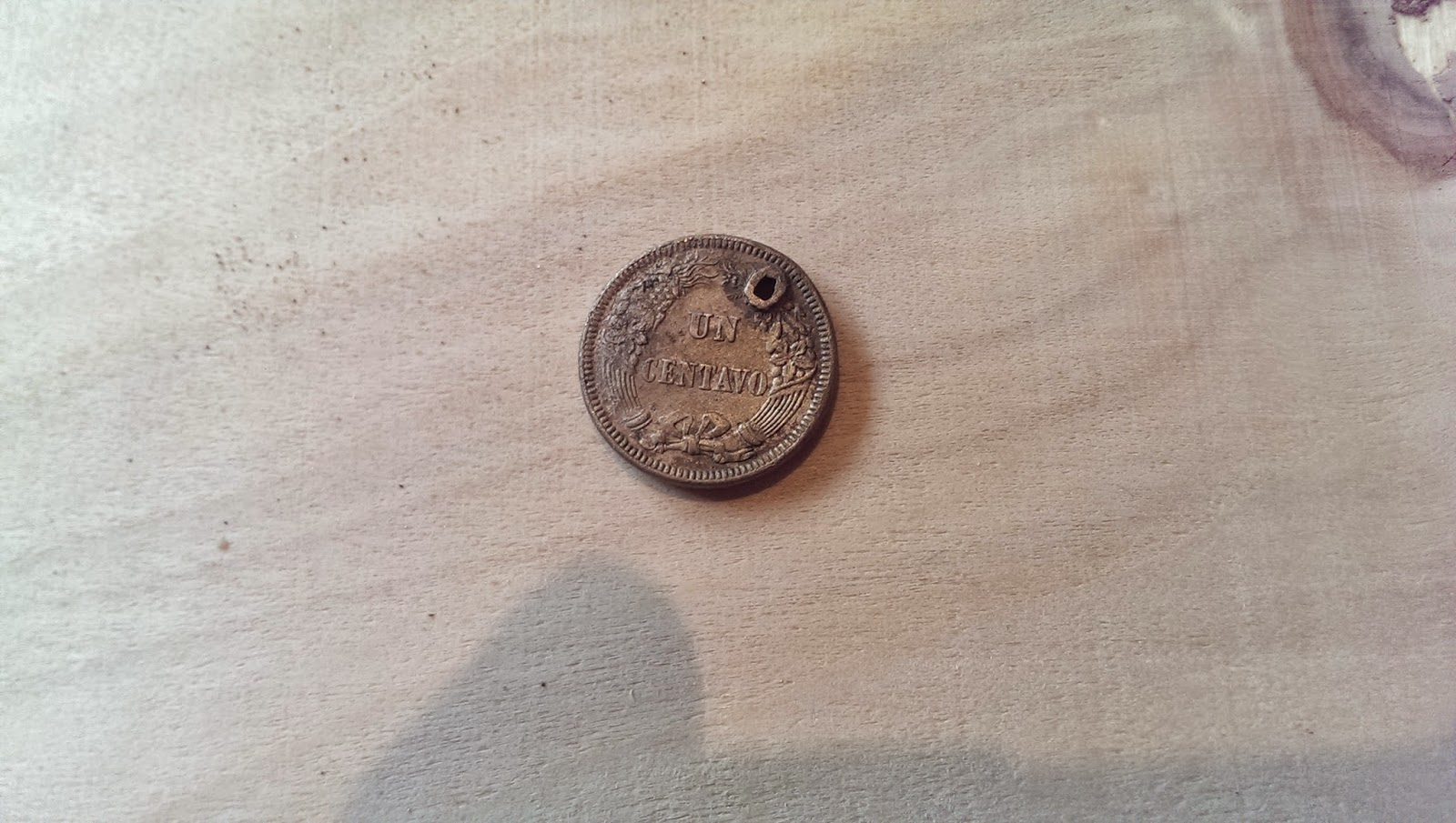A picture of an unknown coin found while metal detecting