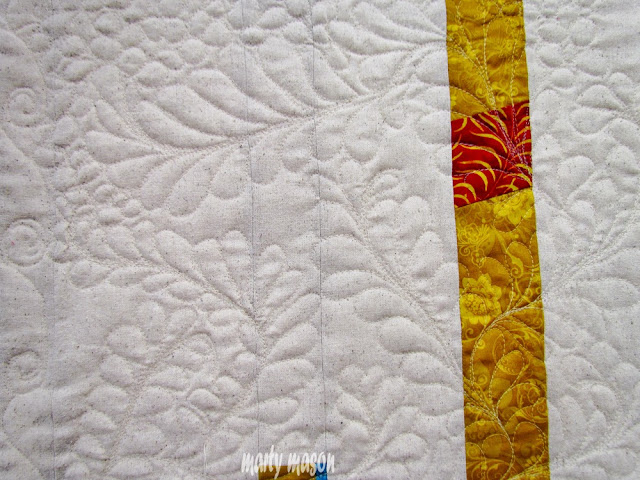 free motion feather quilting
