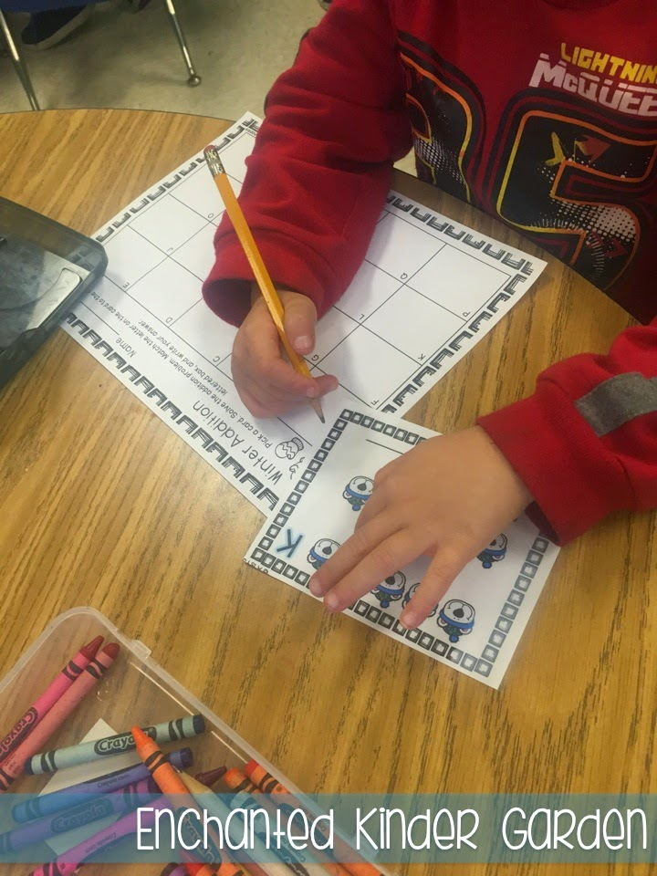This is a photograph of a student completing a math task card activity.
