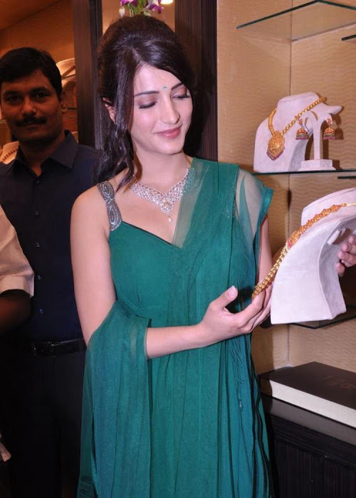 shruti haasan in sleeveless salwar spicy at malabar gold diamonds room launch actress pics