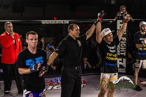 Global Warrior F.C. 2, Josh Hill vs Josh Rettinghouse at Burlington Central Arena in Burlington, Ontario on May 30, 2015. Photo: Jeremy Penn / Pennography  NIKON D7100 AF Zoom 17-55mm f/2.8G 1/400, f/2.8 ISO: 1600