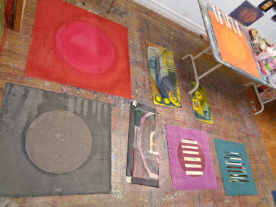 mixed media abstract painting colourful circles and lines in progress