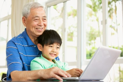 Grandfather and grandson at computer